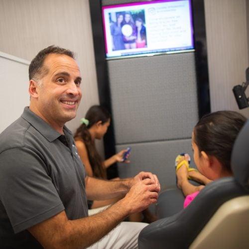 Comella Orthodontics Rochester New York Dr Comella Candids 4 500x500 - Meet Dr. Brandon Comella