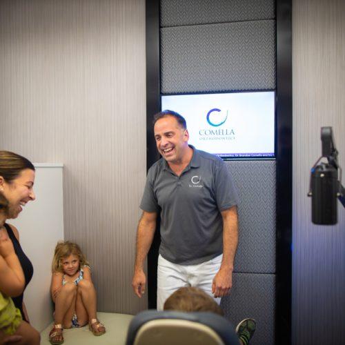 Comella Orthodontics Rochester New York Dr Comella Candids 59 500x500 - Meet Dr. Brandon Comella